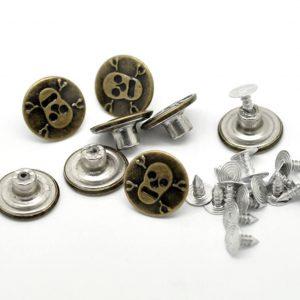 botones de calavera en bronce envejecido